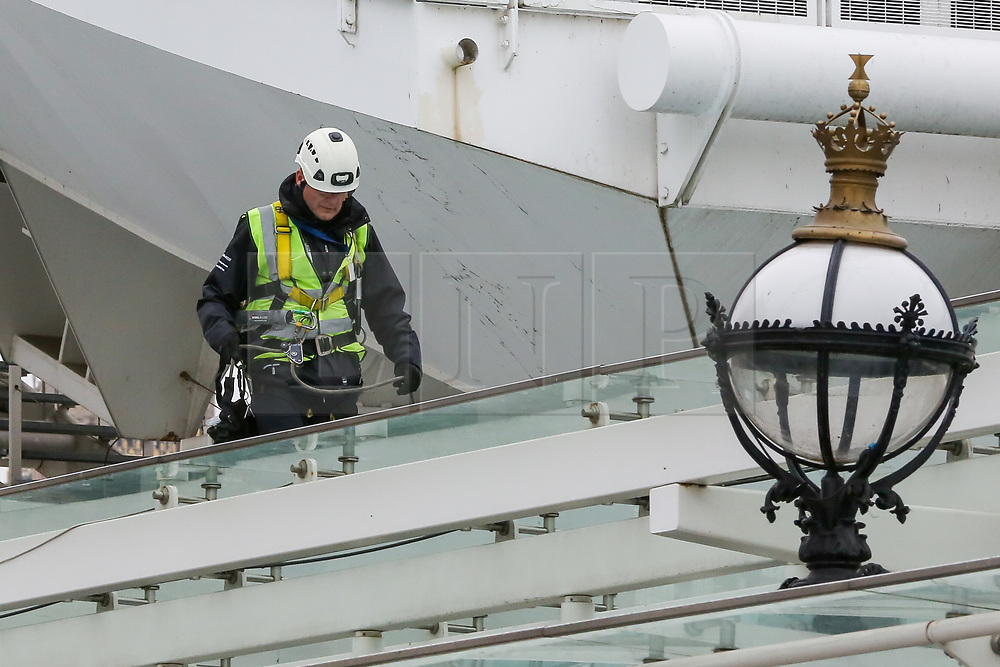 © Licensed to London News Pictures. 07/01/2019. London, UK. A workman on the Coca Cola London Eye which is closed for its annual maintenance refurbishment. The popular tourist attraction is 135m/443ft high and there are 32 capsules attached to the wheel will re-open on 23rd January 2019. The London Eye is Europe's tallest cantilevered observation wheel and over 3.75 million visitors visits the London Eye annually. Photo credit: Dinendra Haria/LNP