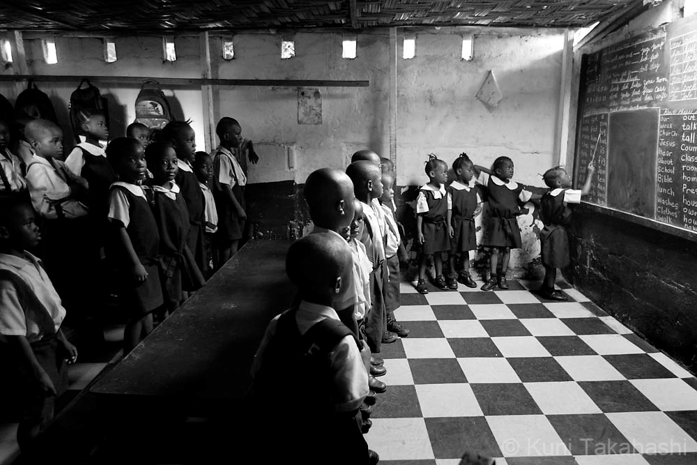Elementary school students study in a classroom, in Monrovia, Liberia, April 22, 2008. After decades of conflict, Liberia is faced with a largely untrained workforce and rebuilding it has posed a challenge with qualified teachers in short supply.