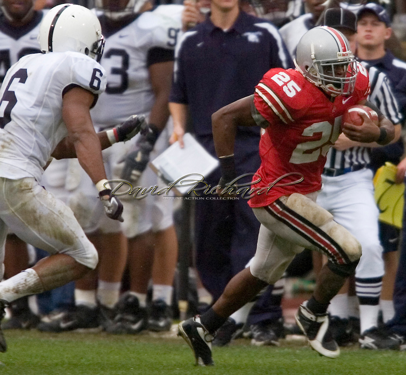 MORNING JOURNAL/DAVID RICHARD.Antonio Pittman of Ohio State gets by the Penn State defense for a first down.