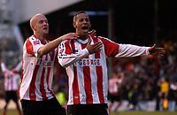 Photo: Daniel Hambury.<br />Brentford v Sunderland. The FA Cup. 28/01/2006.<br />Brentford's Dudley Campbell (R) celebrates his winning goal with Eddie Hutchinson.