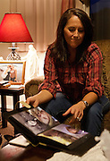 Ellen Hensley, mother of the slain Jerrica Christensen, opens an album with photos of Jerrica and speaks about her family's painful ordeal and legal battles in her Leeds home, Thursday, Dec. 6, 2012.