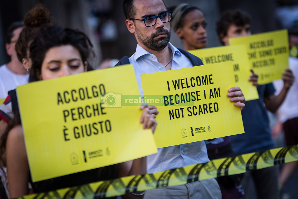 June 20, 2017 - Rome, Italy, Italy - Activists of human rights organization Amnesty International  gather in front of the Pantheon during a Flashmob on World Refugee Day in central Rome . Amnesty International call for the protection of refugees, activate safe channels for asylum seekers and refugees and create an alternative to dangerous irregular crossings...the pictured a moment flash-mob  (Credit Image: © Andrea Ronchini/Pacific Press via ZUMA Wire)