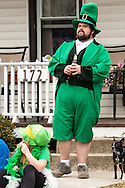 Goshen, New York - Frankie Zeszutek of New Hampton watches the 40th annual Mid-Hudson St. Patrick's Parade on March 13, 2016.