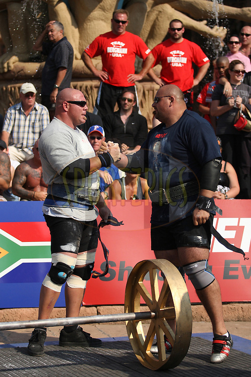 Nick Best (USA) and Laurence Shahlaei (UK) wish each other good luck before starting the overhead lift (for reps), one of the qualifying rounds of the World's Strongest Man competition held in Sun City, South Africa.
