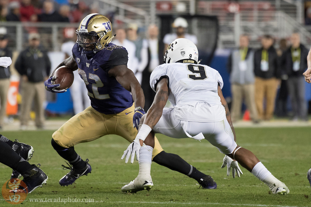 December 2, 2016; Santa Clara, CA, USA; Washington Huskies running back Lavon Coleman (22) runs with the football against Colorado Buffaloes defensive back Tedric Thompson (9) during the fourth quarter in the Pac-12 championship at Levi's Stadium. The Huskies defeated the Buffaloes 41-10.