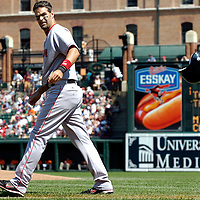 09 September 2007:  Boston Red Sox third baseman Mike Lowell (25) tosses his batting helmet after being called out on strikes to end the 1st inning against Baltimore Orioles pitcher Jeremy Guthrie.  The Red Sox defeated the Orioles 3-2 at Camden Yards in Baltimore, MD.  ****For Editorial Use Only****