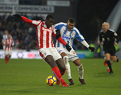 Kurt Zouma of Stoke City (L) and Collin Quaner of Huddersfield Town in action - Mandatory by-line: Jack Phillips/JMP - 26/12/2017 - FOOTBALL - The John Smith's Stadium - Huddersfield, England - Huddersfield Town v Stoke City - English Premier League