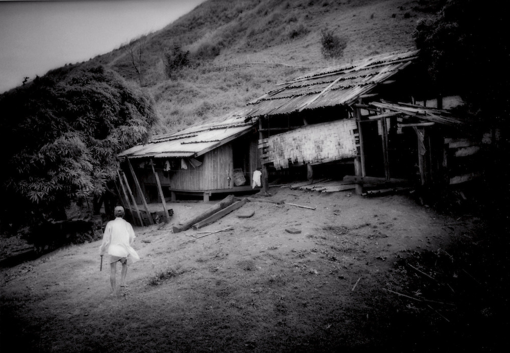 Death Throes of a Great Rainforest - Squatter's shack on the fringe of the Sierra Madre Mountain rainforest encroaching deep into the Agta Negrito people's traditional homeland, Luzon, Philippines  ..Squatter's shack on the fringe of the Sierra Madre Mountain rainforest.  The loggers finish and settlers move in behind them.  The Agta Negritos have all but run out of  room with the forest receeding up from the coast on one side and from the Cagayan Valley from the other.  The forest on the Sierra Madre's west side has been clear cut almost to the base of the mountains, Luzon, Philippines.