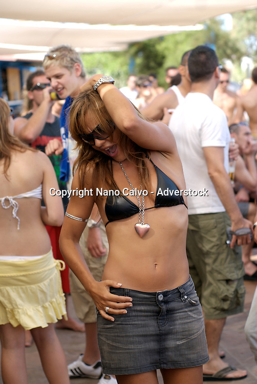 People of all ages and type dancing non stop during the day at popular club Bora Bora, in Playa d´en Bossa, Ibiza, Spain - Photo by Nano Calvo