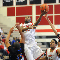 Staff photos by Tom Kelly IV<br /> Coatesville's Jaquan Hollingshed (12) goes up for a layup over Downingtown West's Dion Lattanzi (43) during the Downingtown West at Coatesville boys basketball game on Saturday afternoon January 4, 2014.