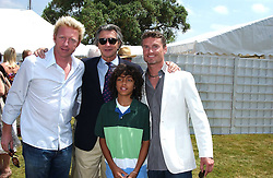 """Left to right, BORIS BECKER, ARNAUD BAMBERGER Boris Becker's son and DAVID COULTHARD at a luncheon hosted by Cartier at the 2005 Goodwood Festival of Speed on 26th June 2005.  Cartier sponsored the """"Style Et Luxe' for vintage cars on the final day of this annual event at Goodwood House, West Sussex. <br /><br />NON EXCLUSIVE - WORLD RIGHTS"""