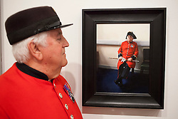 © Licensed to London News Pictures. 20/06/2012. LONDON, UK. Tom, a Chelsea Pensioner, looks on at his portrait painted by artist Louise Pragnell entitled 'Tom, Waiting', hung as one of the featured works at this years BP Portrait Award.  The annual British Petroleum sponsored event runs from the 21st of June to the 23rd of September and highlights the work of portrait artists working in a variety of styles and techniques . Photo credit: Matt Cetti-Roberts/LNP