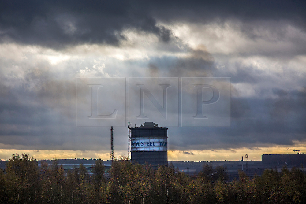 © Licensed to London News Pictures. 10/11/2015. Scunthorpe, UK. Picture shows the Tata Steel plant in Scunthorpe this morning. A march in Scunthorpe is taking place to support the 900 Tata Steel workers who are to be made redundant at the Steel plant. The industry blames cheap Chinese imports for a collapse in steel prices. Tata has pledged £3m to help create jobs in the town, with another £6m provided by the government. Photo credit: Andrew McCaren/LNP