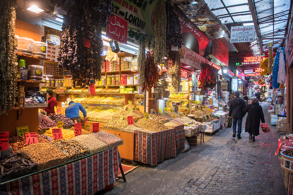 View down narrow passageway lined with stores selling a variety of spices and other goods, Istanbul, Turkey