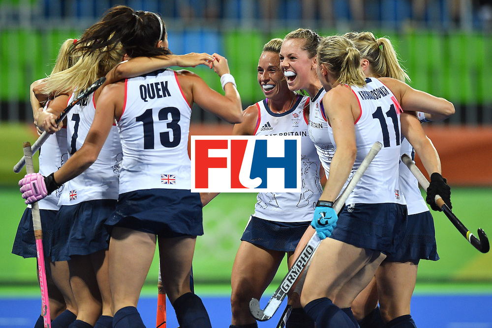 Britain's Georgie Twigg (3rd R) celebrates the opening goal during the women's quarterfinal field hockey Britain vs Spain match of the Rio 2016 Olympics Games at the Olympic Hockey Centre in Rio de Janeiro on August 15, 2016. / AFP / Carl DE SOUZA        (Photo credit should read CARL DE SOUZA/AFP/Getty Images)