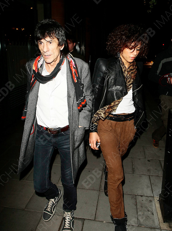 06.MARCH.2010 - LONDON<br /> <br /> RONNIE WOOD AND GIRLFRIEND ANA ARAUJO LEAVING CIPRIANI'S RESTAURANT IN MAYFAIR AFTER HAVING DINNER WITH RONNIE'S SON JESSE, WITH RONNIE BUYING A COPY OF THE BIG ISSUE ON THE WAY OUT.<br /> <br /> BYLINE: EDBIMAGEARCHIVE.COM<br /> <br /> *THIS IMAGE IS STRICTLY FOR UK NEWSPAPERS AND MAGAZINES ONLY*<br /> *FOR WORLD WIDE SALES AND WEB USE PLEASE CONTACT EDBIMAGEARCHIVE - 0208 954 5968*