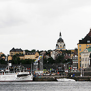 Gamla Stan, Old Town, seen from Stockholm across the water. Gamla Stan with its narrow cobble stones streets is a wonderful to explore on foot.<br /> Jose More Photography