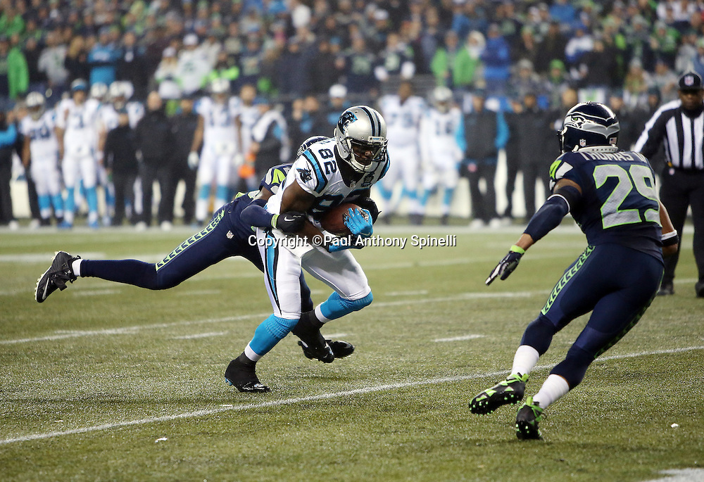 Carolina Panthers wide receiver Jerricho Cotchery (82) catches a fourth quarter for a 9 yard gain to the Seattle Seahawks 16 yard line as he gets tackled by Seattle Seahawks cornerback Jeremy Lane (20) while Seattle Seahawks free safety Earl Thomas (29) closes in on defense during the NFL week 19 NFC Divisional Playoff football game against the Seattle Seahawks on Saturday, Jan. 10, 2015 in Seattle. The Seahawks won the game 31-17. ©Paul Anthony Spinelli