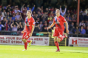 York take the lead from James Berrett during the Capital One Cup match between York City and Bradford City at Bootham Crescent, York, England on 11 August 2015. Photo by Simon Davies.