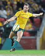 Quade Cooper goes to the air for Australia during action from the Rugby Union Test Match played between Australia and Ireland at Suncorp Stadium (Brisbane) on Saturday 26th June 2010 ~ Australia (22) defeated Ireland (15) ~ © Image Aura Images.com.au ~ Conditions of Use: This image is intended for Editorial use as news and commentry in print, electronic and online media ~ Required Image Credit : Steven Hight (AURA Images)For any alternative use please contact AURA Images