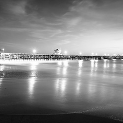 San Clemente California pier black and white picture. San Clemente is a popular beach city in Orange County California in the United States of America. Copyright ⓒ 2017 Paul Velgos with all rights reserved.