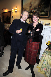 DAN TOPOLSKI and his wife SUSAN GILMOUR at a birthday party for Lady Meyer hosted by Richard & Basia Briggs at their home 25 Sloane Gardens, London SW1 on 28th January 2009.