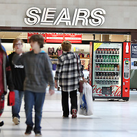 Shoppers walk inside of the Mall at Barnes Crossing in front of Sears on Tuesday morning in Tupelo.