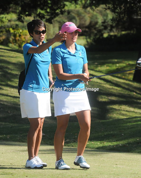 UNCW Head Coach Cindy Ho, left, instructs Elizabeth Hall before a tee shot Sunday October 26, 2014 during the 13th annual Landfall Tradition in Wilmington, N.C. (Jason A. Frizzelle)