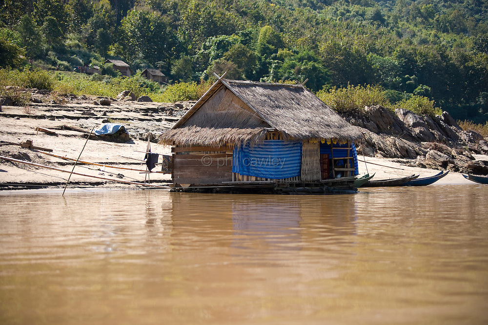 Mekong river, Northern Laos - A floating store near a small village between Huay Xai and Luang Prabang.
