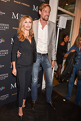 Peter Crouch and Abbey Clancy at a private view of work by Bradley Theodore entitled 'The Second Coming' at the Maddox Gallery, 9 Maddox Street, London England. 19 April 2017.