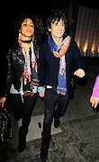 18.MARCH.2010 - LONDON<br /> <br /> RONNIE WOOD AND HIS BRAZILIAN GIRLFRIEND ANA ARAUJO LEAVING THE SHOEBOX ART AUCTION AND EXHIBITION IN MAYFAIR WEARING MATCHING UGG STYLE BOOTS.<br /> <br /> BYLINE: EDBIMAGEARCHIVE.COM<br /> <br /> *THIS IMAGE IS STRICTLY FOR UK NEWSPAPERS & MAGAZINES ONLY*<br /> *FOR OTHER REGIONS PLEASE CONTACT EDBIMAGEARCHIVE - 0208 954 5968*