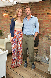 ELOISE SHOWERING and PATRICK GRANT at the Warner Music Group Summer Party in association with British GQ held at Shoreditch House, Ebor Street, London E2 on 8th July 2015.