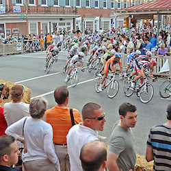 The Iron Hill Twilight Criterium Pro Men's race rounds the corner at Market and Church Streets in West Chester. TK4