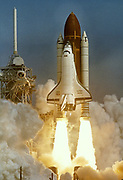 The Shuttle Atlantis lifts-off from launch pad 39-B at Kennedy Space Center 5 April, 1991 carrying a five-man crew and 17-ton Gamma Ray Observatory.  The payload will allow a look at dep space gamma emissions.