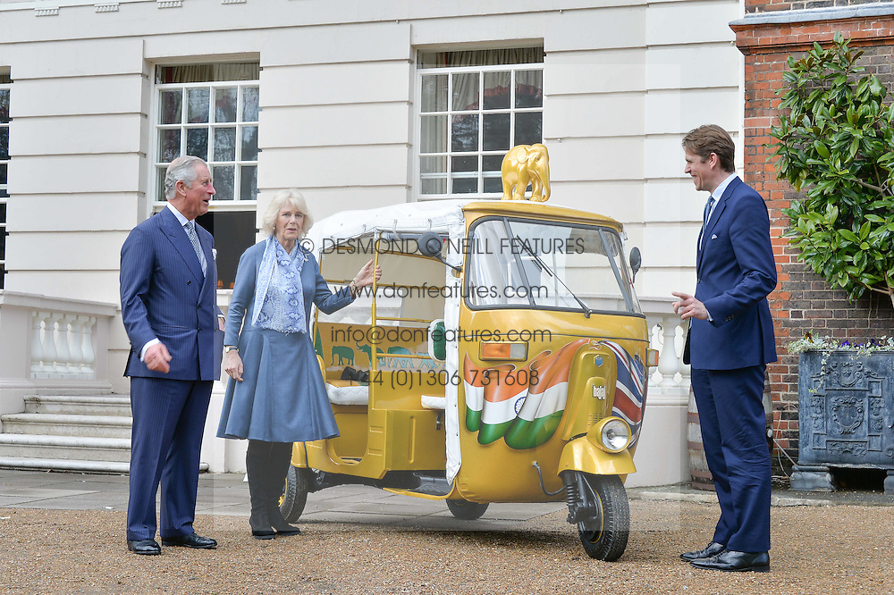 Thursday 26th March 2015, The Elephant Family charity and Quintessentially Foundation announced the launch of 'Travels To My Elephant' – a once-in-a-lifetime rickshaw race taking place in India in November 2015. The official launch of the venture took place at Clarence House at an exclusive reception hosted by TRH The Prince of Wales and The Duchess of Cornwall,  joint patrons of Elephant Family.<br /> Picture shows:-The Prince of Wales, the Duchess of Cornwall and Ben Elliot,