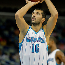Oct 10, 2009; New Orleans, LA, USA; New Orleans Hornets forward Peja Stojakovic (16) shoots a technical foul free throw during a preseason game against the Oklahoma City Thunder at the New Orleans Arena. The Hornets defeated the Thunder 88-79. Mandatory Credit: Derick E. Hingle-US PRESSWIRE