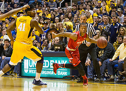 Mar 2, 2016; Morgantown, WV, USA; Texas Tech Red Raiders guard Devon Thomas (2) dribbles past West Virginia Mountaineers forward Devin Williams (41) during the first half at the WVU Coliseum. Mandatory Credit: Ben Queen-USA TODAY Sports