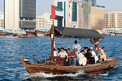 View of Abra water taxi on Creek in Old Dubai in United Arab Emirates UAE