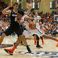 Colorado's Thomas Akyazili, left, tries to stop Oregon State's Stephen Thompson Jr. from getting to the basket in the first half of an NCAA college basketball game in Corvallis, Ore., on Saturday, Feb. 6, 2016. (AP Photo/Timothy J. Gonzalez)