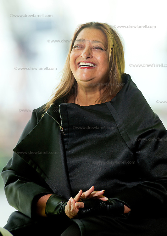 Picture shows Architect Zaha Hadid.Zaha Hadid's Riverside Museum. Glasgow, Scotland, UK.Press Launch with Architect Zaha Hadid.Glasgow's new waterfront home for the city's unique collection of transport , engineering and shipbuilding legacy which made Glagow great . Designed by Iraqi architect Zaha Hadid. This is her first major public commission to open in the UK. The seventy four million pound glass and zinc clad museum stands beside the River Clyde and  is able  to house over 3,000 items from the collection inside the pistachio coloured interior. Vintage cars sit alongside steam locomotive engines, diesels, bikes and skateboards.  Three walk through 1900s street scene gives visitors a flavour of  a bygone Glagow and over 150 interactive displays telling the stories of the people  who made the term 'Clyde Built' brings the experience up to date.  It also houses the city's unrivalled ship model collection.   Outside, the refitted Tall Ship Glenlee is moored in front of the  museums dramatic south facade.  After getting the go-ahead in 2002, work on-site at the historic Pointhouse Quay, began in 2007, with  the main contractors BAM, using 2,500 tonnes contructing the roof , without any internal supporting columns  in a feat of  architectural  engineering innovation. The Museum opens to the public on the 21st June 2011.Picture Drew FarrellFriday 10th June 2011.