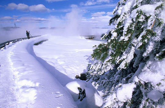 Yellowstone National Park. Photographer at West Thumb Geyser Basin. Winter.