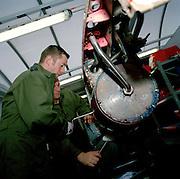 Engineering ground staff of the Red Arrows, Britain's RAF aerobatic team, perform scheduled maintenance on Hawk equipment.
