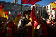 """Spain, Barcelona: Thousands of protesters take to the streets during a demonstration called by """"Societat Civil Catalana"""" (Catalan Civil Society) to support the unity of Spain on October 8, 2017 in Barcelona.  Catalans calling themselves a """"silent majority"""" opposed to leaving Spain broke their silence after a week of mounting anxiety over the country's worst political crisis in decades."""