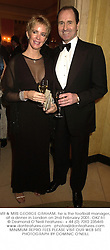 MR & MRS GEORGE GRAHAM, he is the football manager, at a dinner in London on 2nd February 2001.OKZ 61
