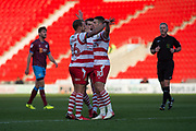 Doncaster celebrate as Doncaster Rovers Midfielder Tommy Rowe (10) scores a goal 1-0 during the The FA Cup match between Doncaster Rovers and Scunthorpe United at the Keepmoat Stadium, Doncaster, England on 3 December 2017. Photo by Craig Zadoroznyj.