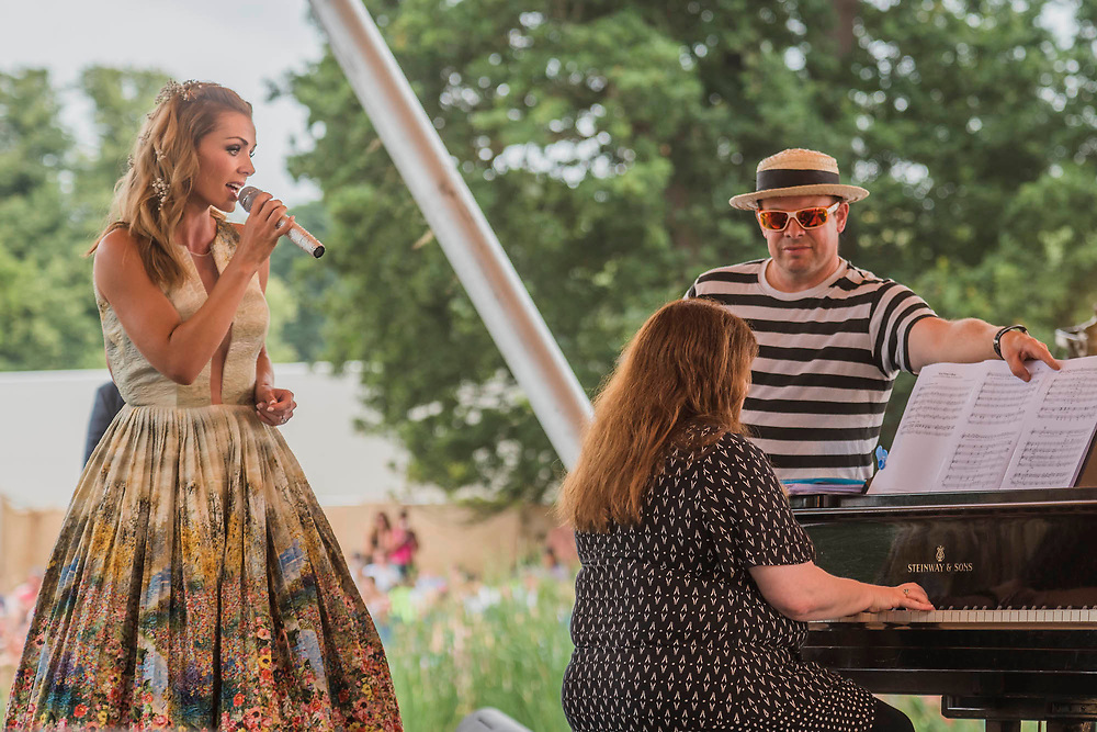 Katherine Jenkins arrives by punt and sings on the Waterfront stage in front of a large crowd as one of the punters turns the music for her pianist - The 2017 Latitude Festival, Henham Park. Suffolk 16 July 2017