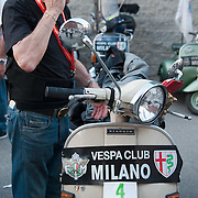 MILAN, ITALY - JUNE 05:  A participant makes a phone call before the start of the Vespa race on June 5, 2010 in Milan, Italy. Vespa is one of the best known Italian icons, the special Vespa weekend is the XV edition of the famous  500km night race  (Photo by Marco Secchi/Getty Images)