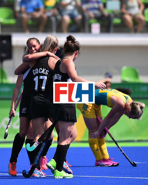 New Zealands's players (L) celebrate at the end of the women's quarterfinal field hockey New Zealand vs Australia match of the Rio 2016 Olympics Games at the Olympic Hockey Centre in Rio de Janeiro on August 15, 2016. / AFP / Carl DE SOUZA        (Photo credit should read CARL DE SOUZA/AFP/Getty Images)