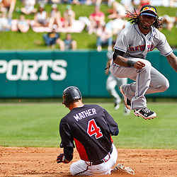 March 5, 2011; Lake Buena Vista, FL, USA; New York Mets shortstop Jose Reyes (7) forces out and jumps over Atlanta Braves outfielder Joe Mather (4) and throws to complete a double play during a spring training exhibition game at Disney Wide World of Sports complex.  Mandatory Credit: Derick E. Hingle