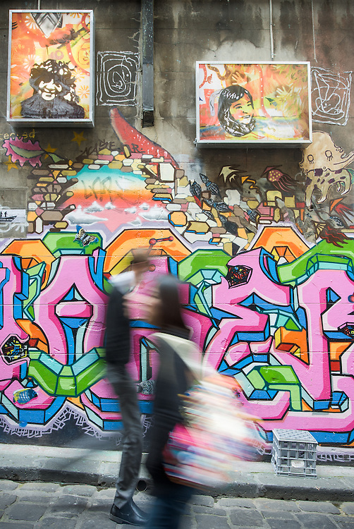 Walking past graffiti in Hosier Lane, Melbourne.